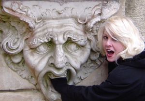 Me, getting eaten by a gargoyle during my visit to the UK.